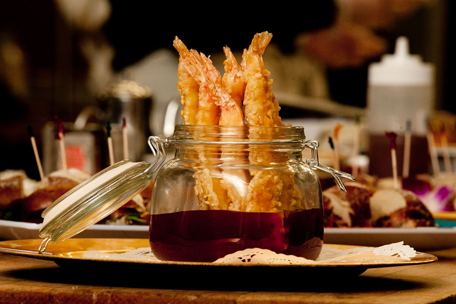 prawns in a mason jar with a purple sauce