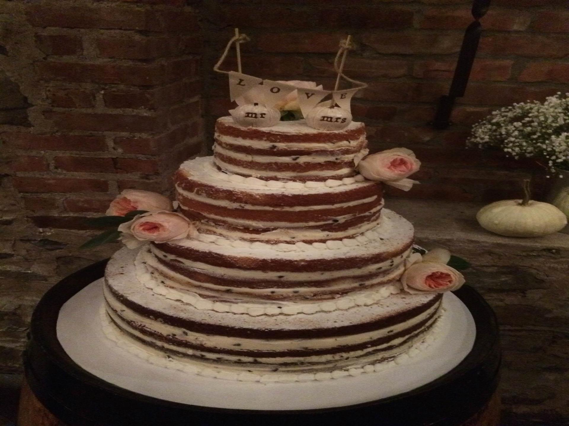 naked cake topped with peonys