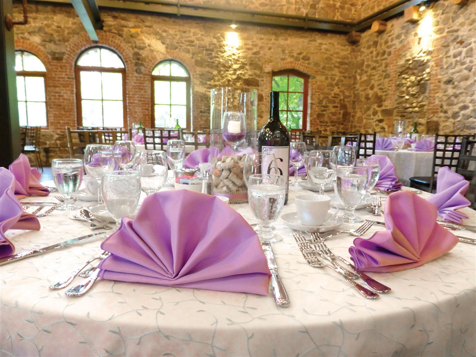 banquet table set with purple linens