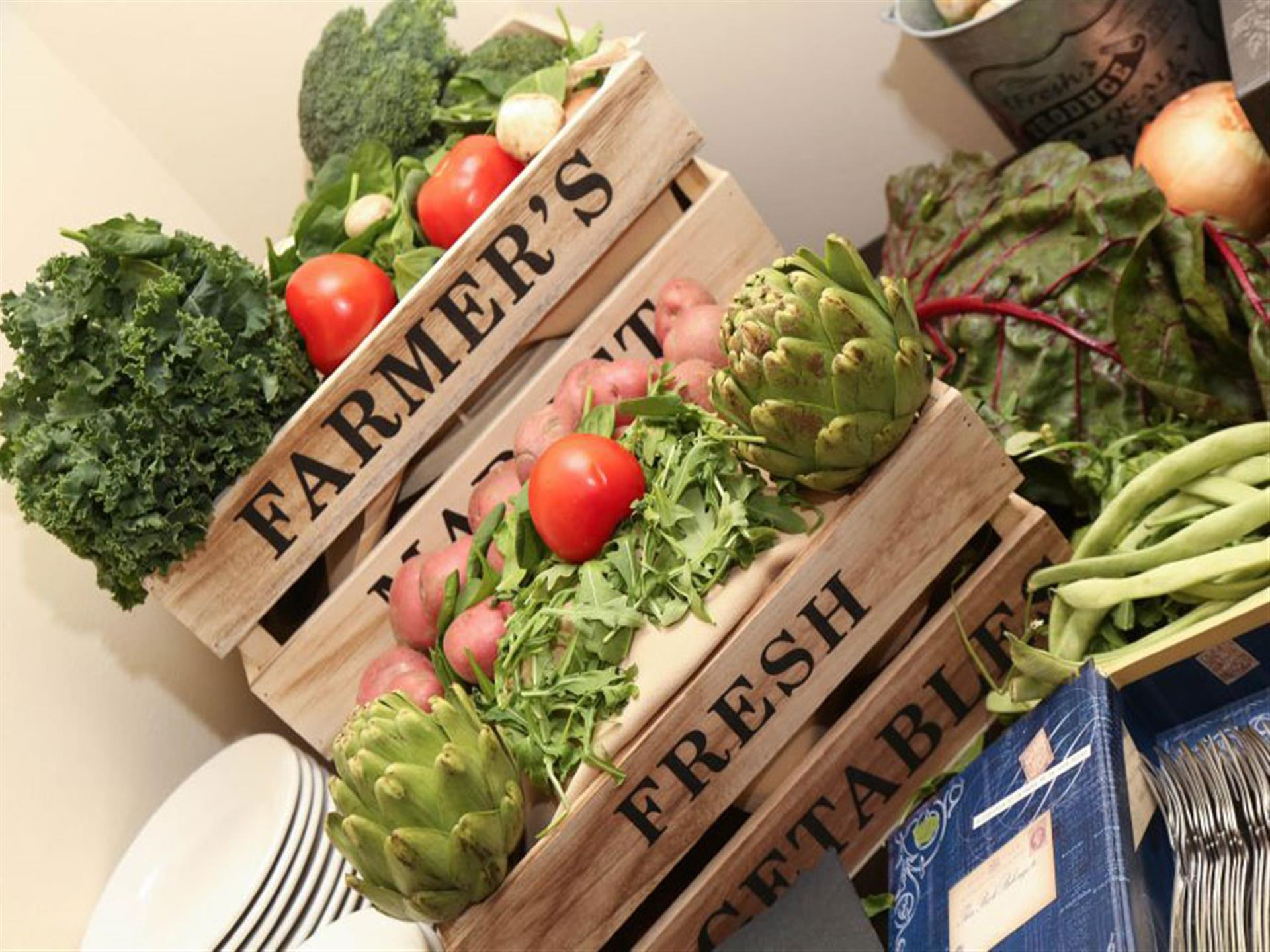 tablescape set with vegetabkes and farmer's market crates