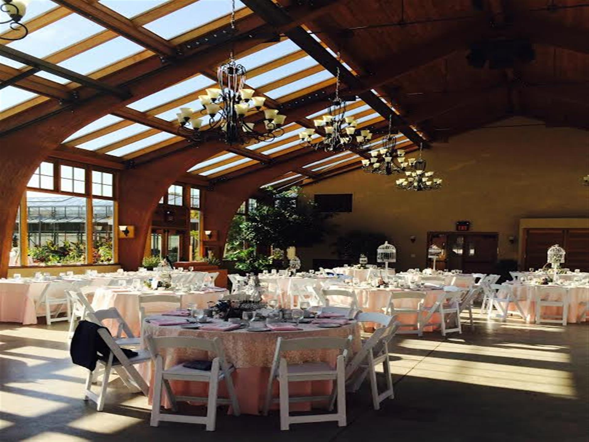 banquet tables set inside dining room with glass ceilings