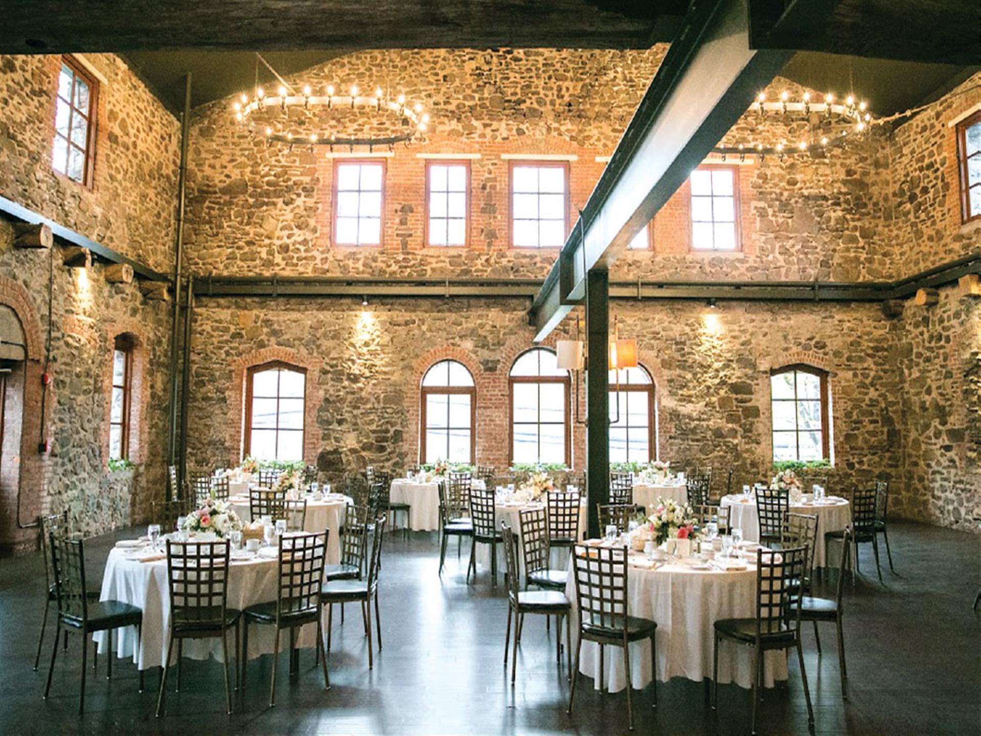 interior of brotherhood winery showcasing large chandeliers and stone walls