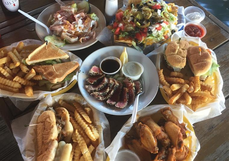 Seared Ahi Tuna, buffalo wings, cheese burger and fries, taco salad, club sandwich and fries