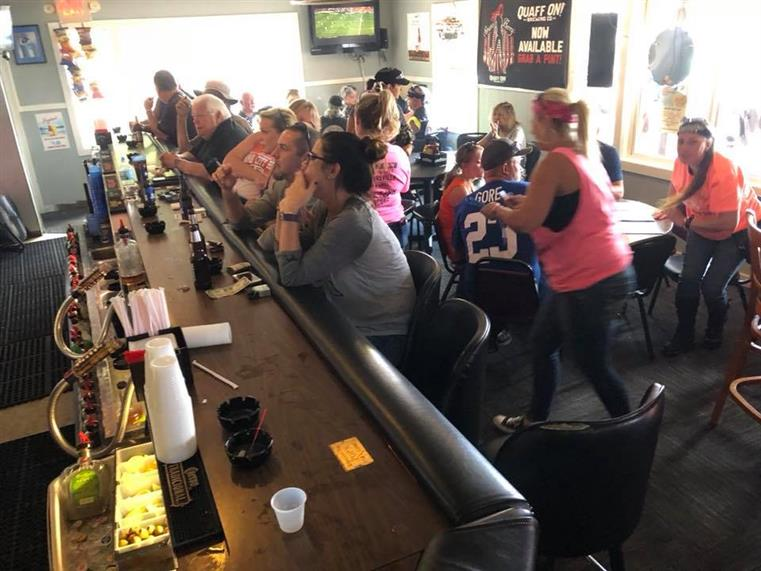 customers sitting at the bar