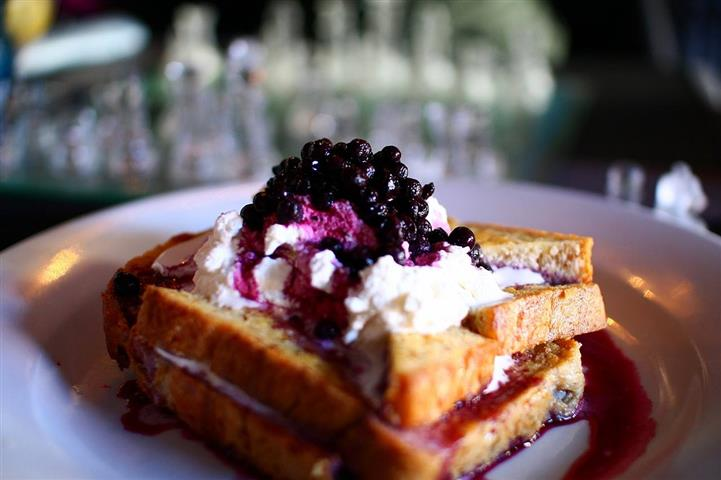 french toast topped with whipped cream and blueberries