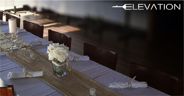 table seating decorated with utensils rolled in the napkins