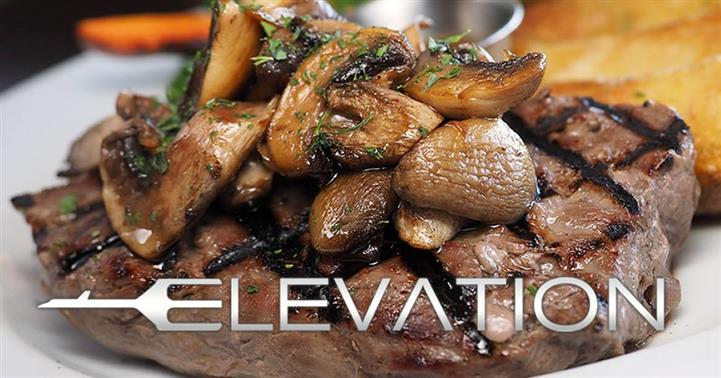 steak topped with cooked mushrooms