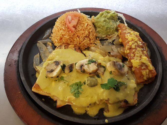 Fernado Special. Served with chicken breast, chile con queso, spicy on top, mushrooms, one cheese enchilada spicy, guacamole, rice, and flour tortillas