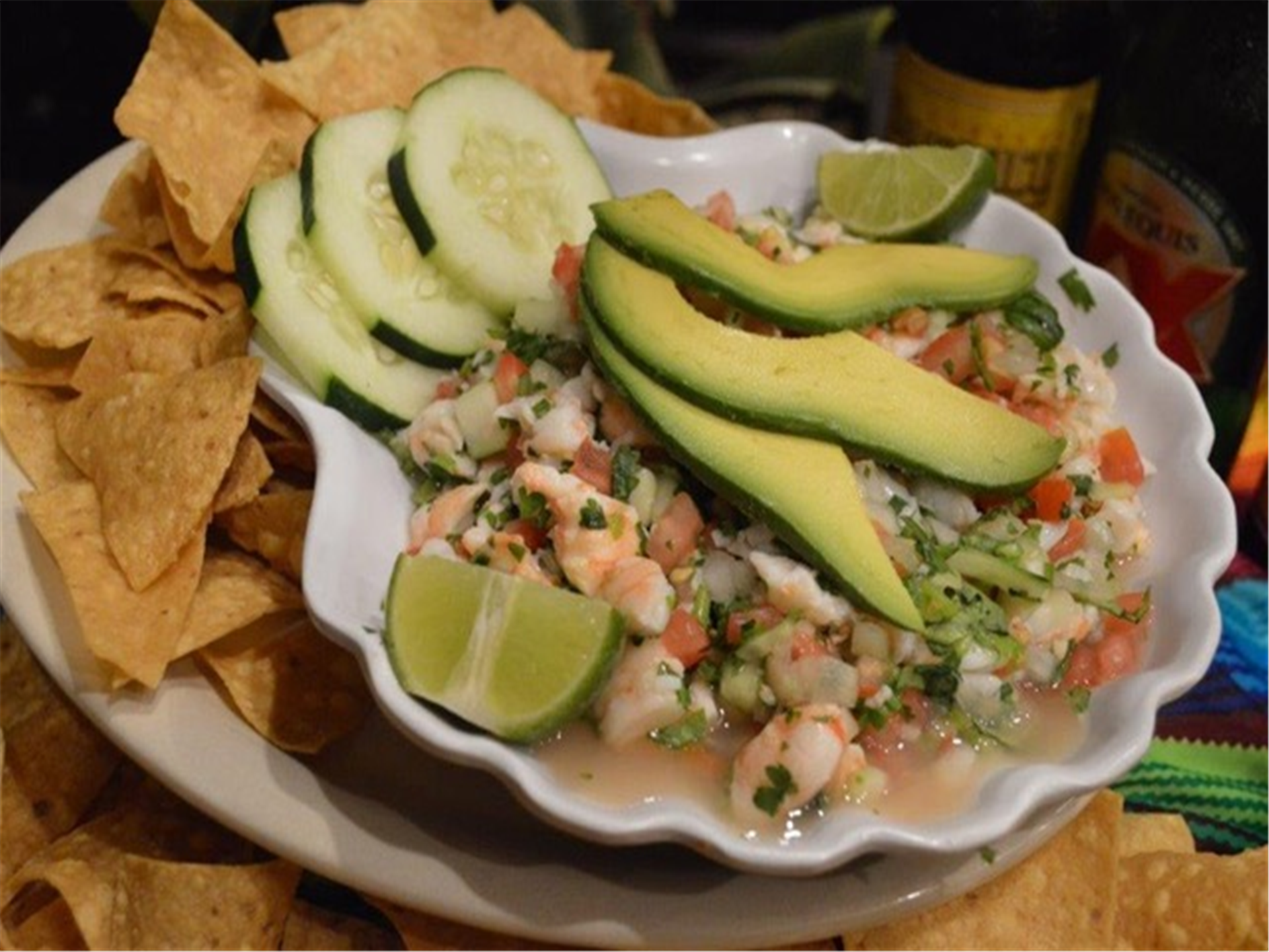 Shrimp cooked in lime juice, chopped fine onions, tomatoes & cilantro. Topped with slices of avocados. Served with chips or saltine crackers