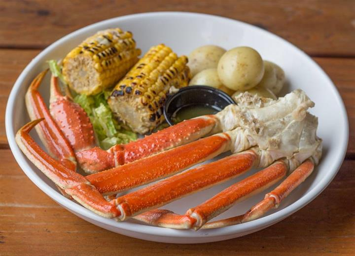 crab legs with potaties and corn