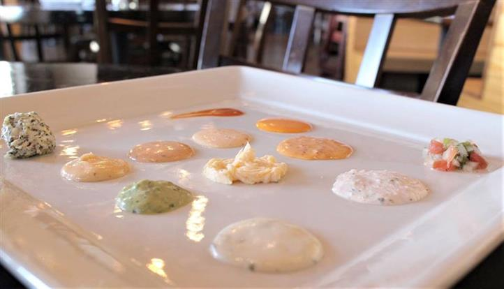 various dipping sauces on a plate