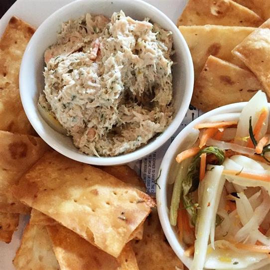shrimp salad with pita chips and a side of coleslaw