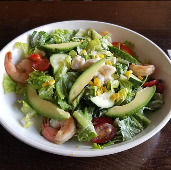 garden salad with shrimp, avocado, cheese and cucumbers