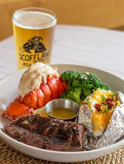 surf and turf plate served with a pint of beer