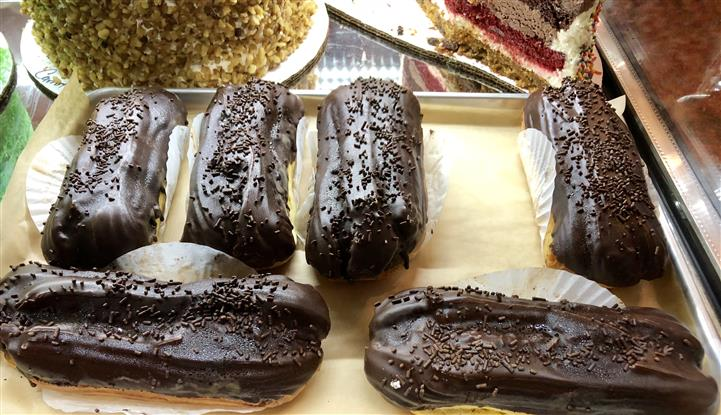 chocolate eclair desserts being displayed