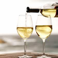two glasses of white wine being poured