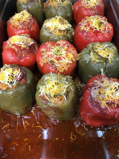 stuffed peppers together in a metal tray