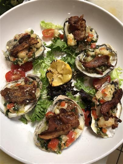 stuffed oysters over salad