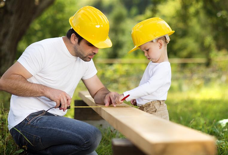A father and sun with construction hats