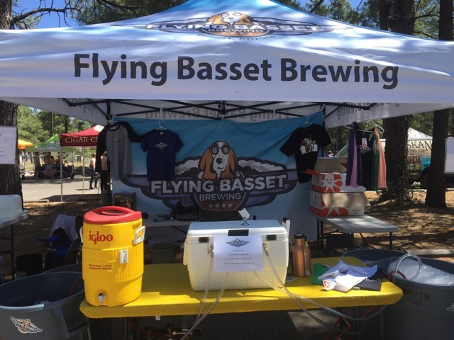 flying basset brewing tent set up at a craft fair