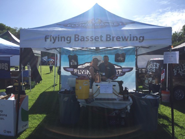flying basset brewing stand at a craft fair
