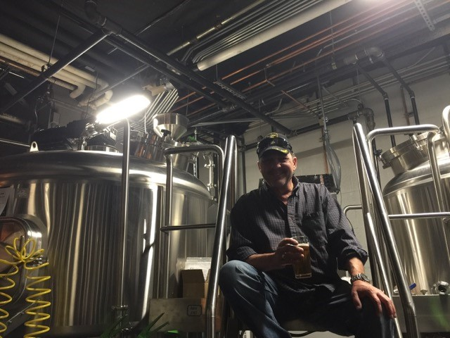 brewing process showcasing a brewmaster tasting the beer