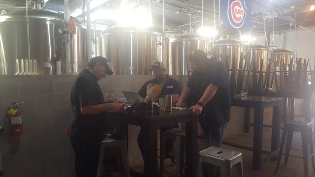 brewmasters sitting around a table discussing operations