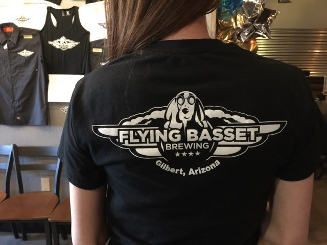 waitress wearing flying basset brewing t-shirt