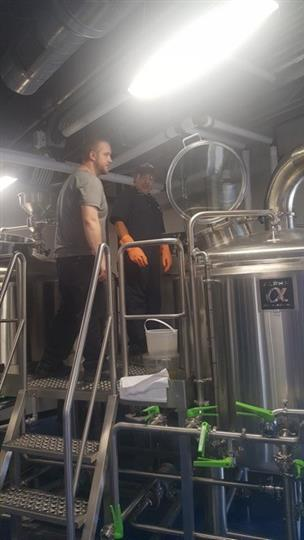 brewing process showcasing the metal containers for the beer