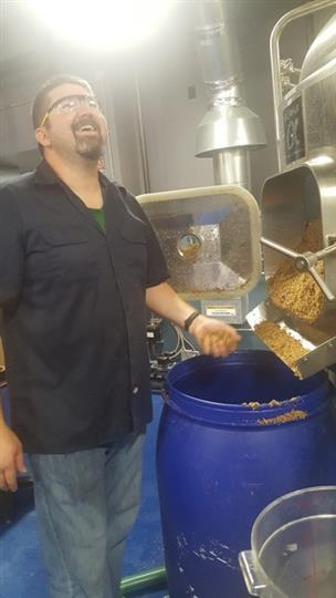 brewing process showcasing grains and mash being poured into a barrel