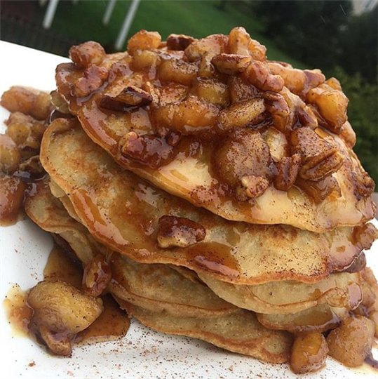 stacked pancakes covered with syrup