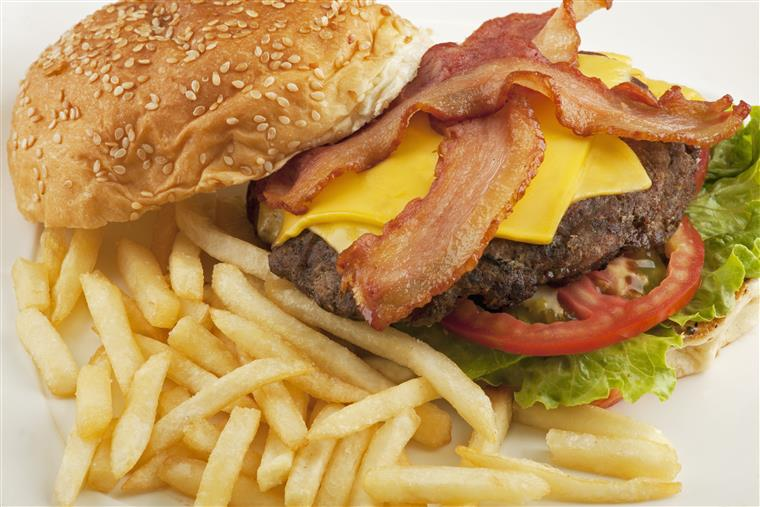 Cheeseburger with bacon, lettuce, tomatoes. Side of fries.