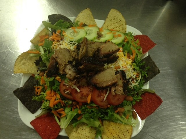 mexican salad with chips and smoked meat