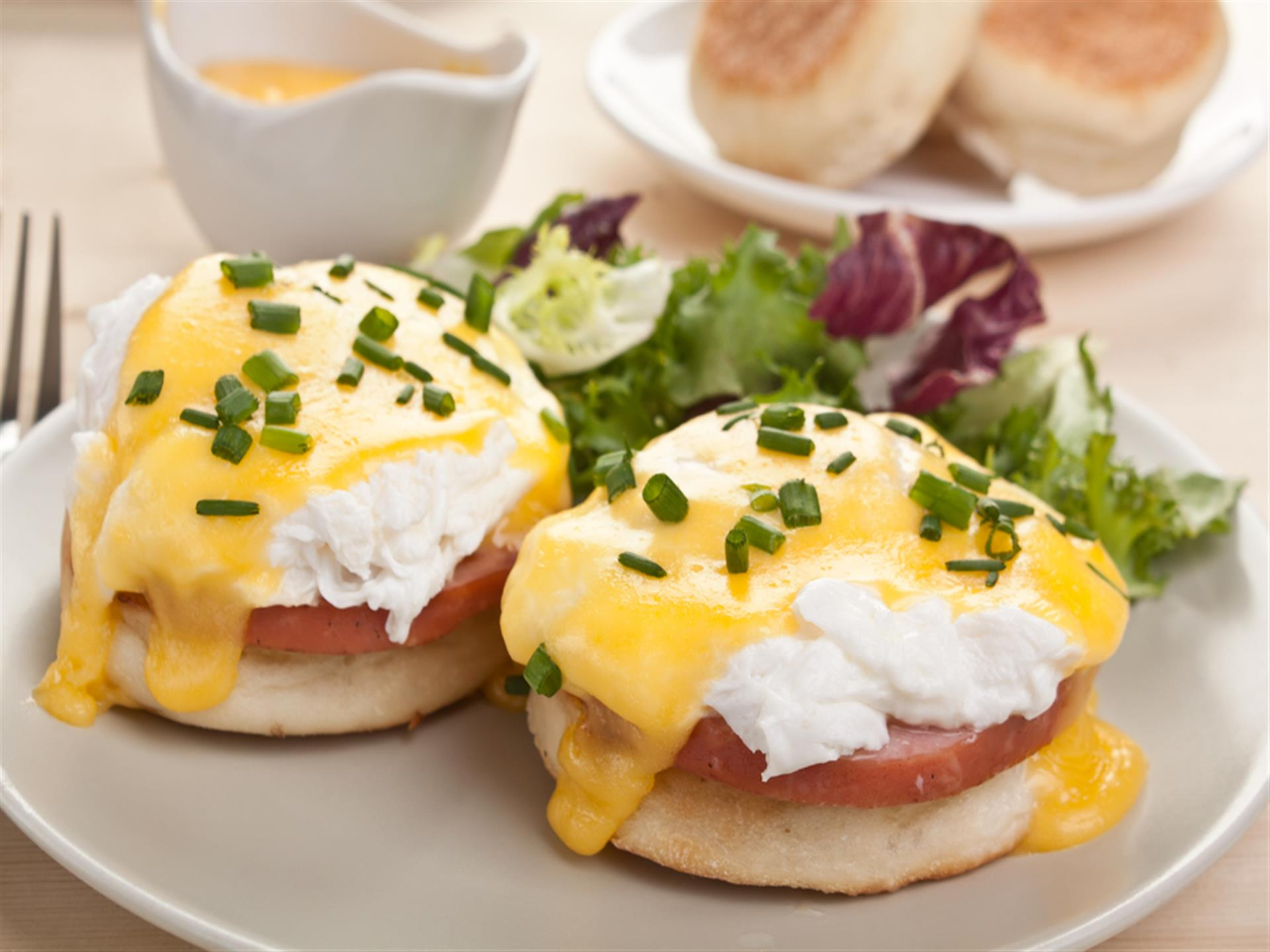 Eggs benedict with candian bacon and side salad