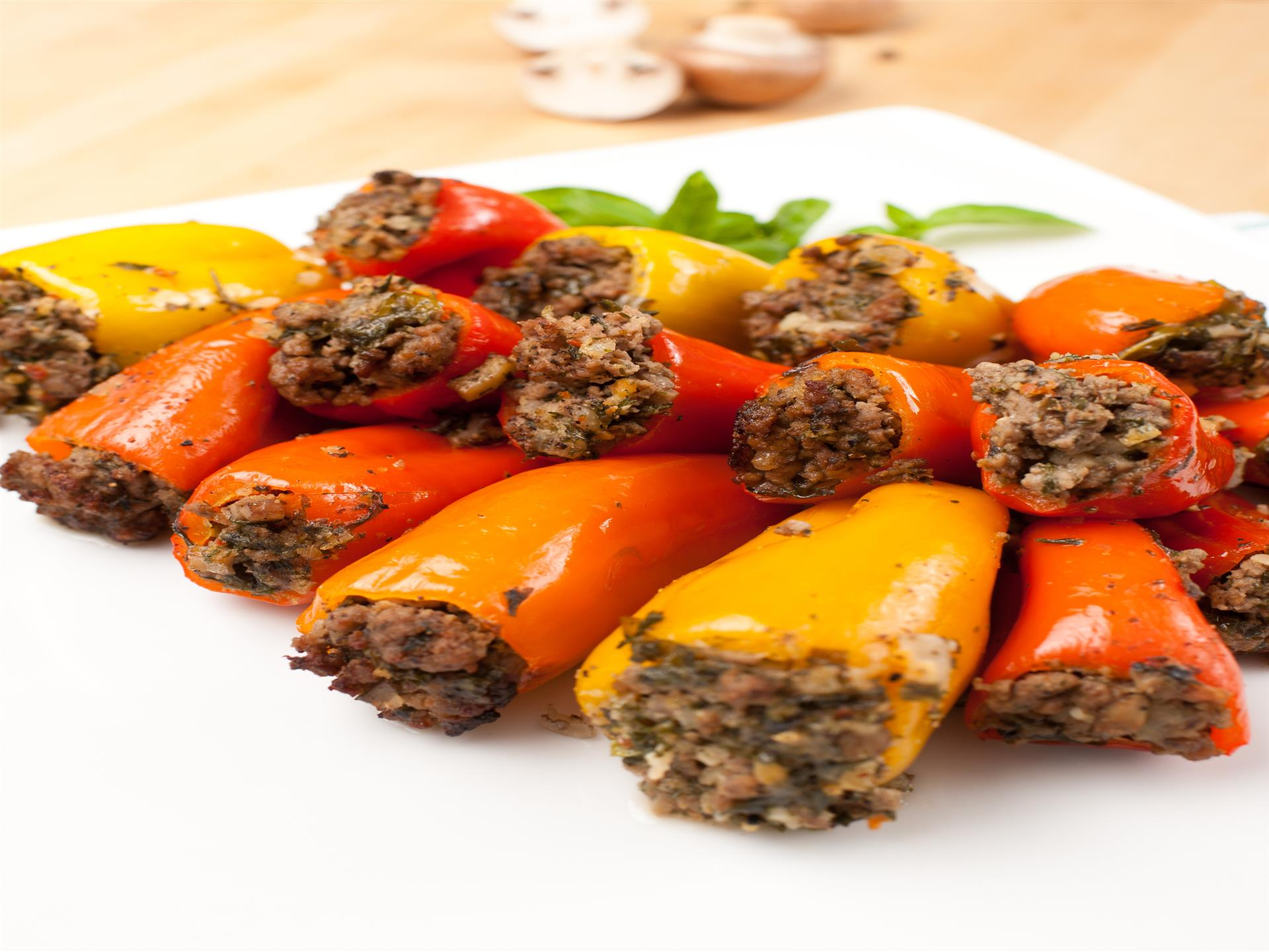 Red, yellow, and orange peppers stuffed with beef
