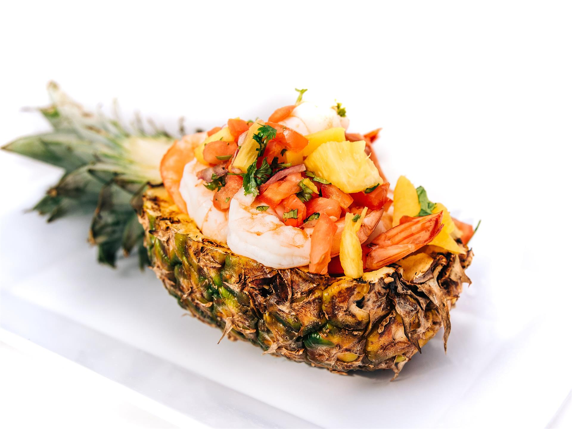 Shrimp served in a pineapple bowl