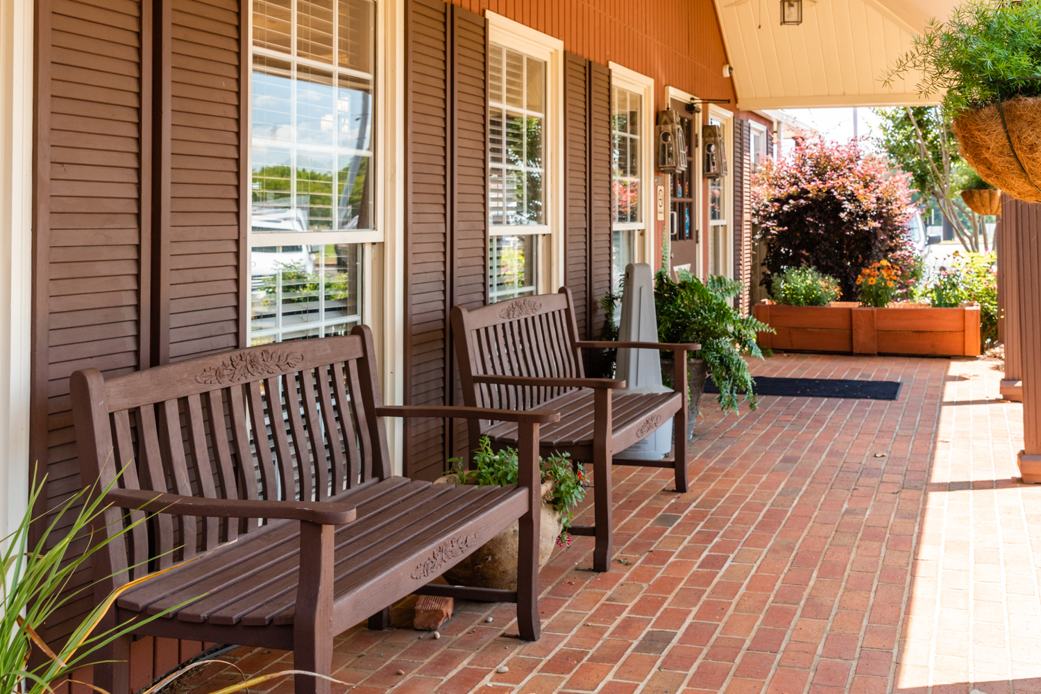 Front porch with benches outside of restaurant entrance.