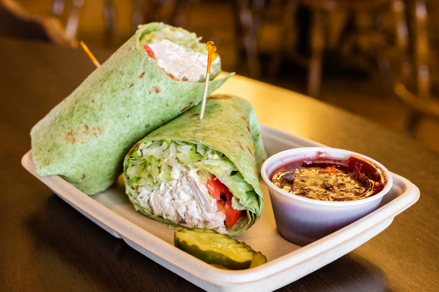 Turkey salad wrap. Spinach herb wrap with turkey, lettuce, tomatoes, mayonnaise.