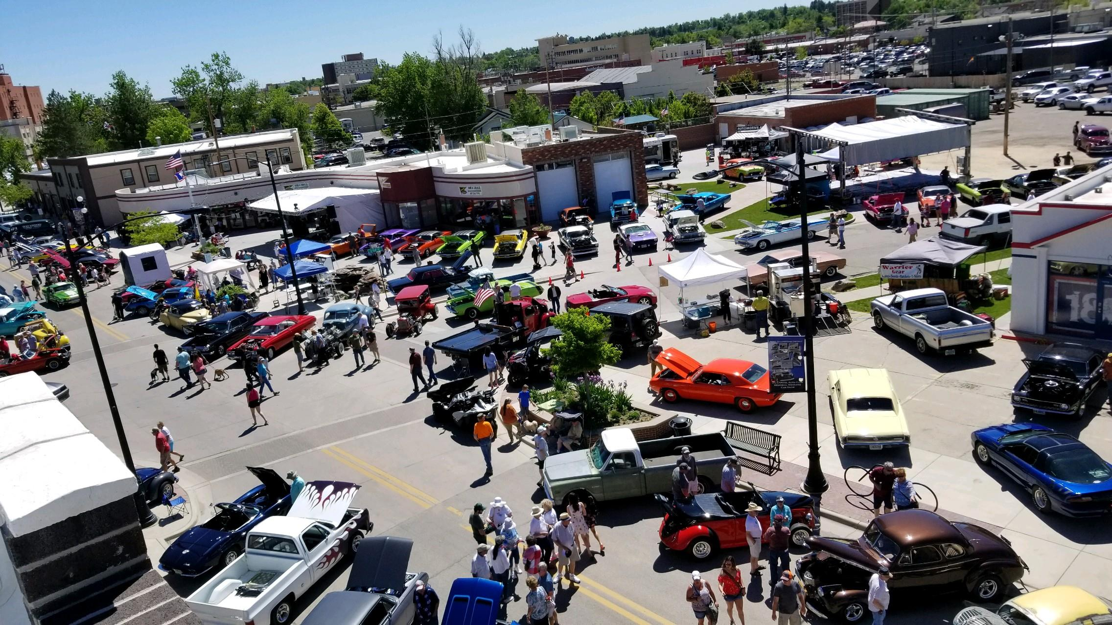 Town street full of cars and trucks for a car show