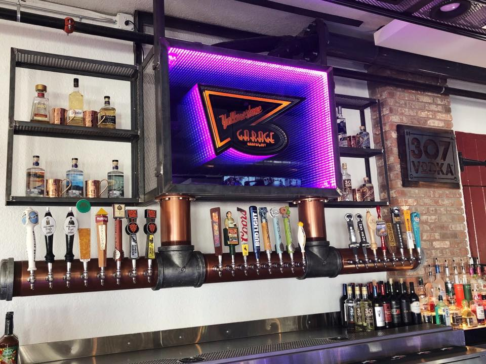 back of bar with beer taps on wall