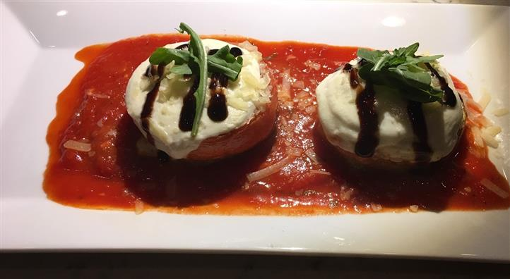 stuffed tomatoes with cheese, sauce and herbs