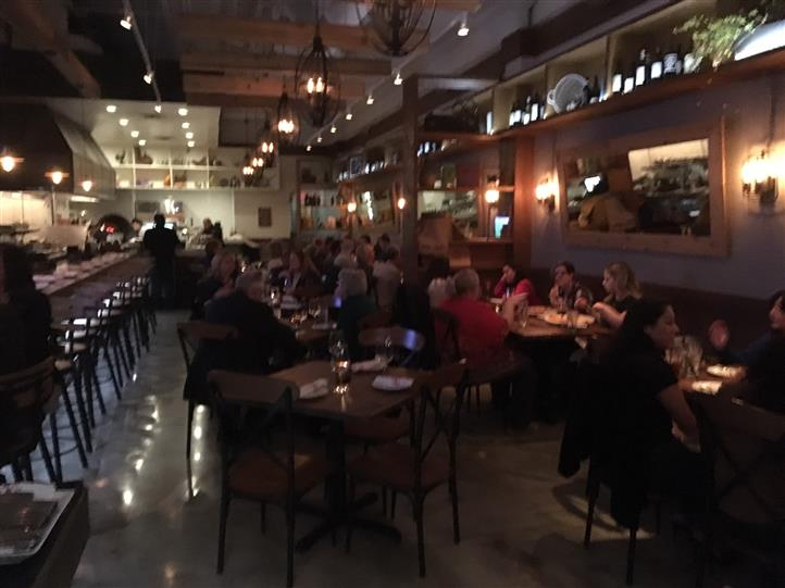 inside panevino osteria showcasing a crowded night in the dining area