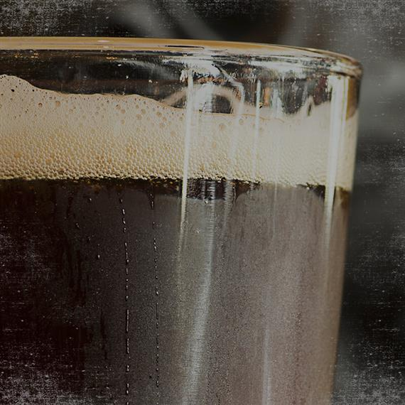 pint of dark beer up close