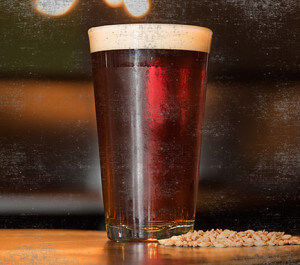 dark amber beer filled pint glass