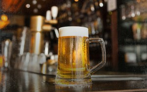 light beer filled pint glass mug