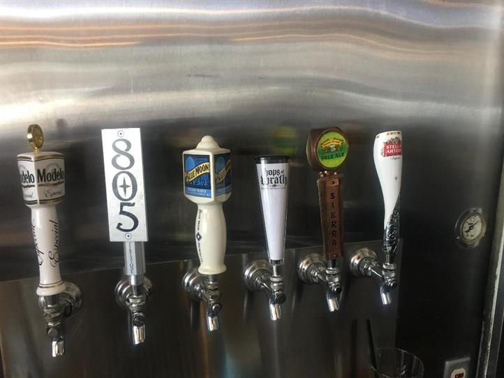 Beer taps. Modelo, 805, blue moon, hops of wrath, sierra pale ale, stella artois.