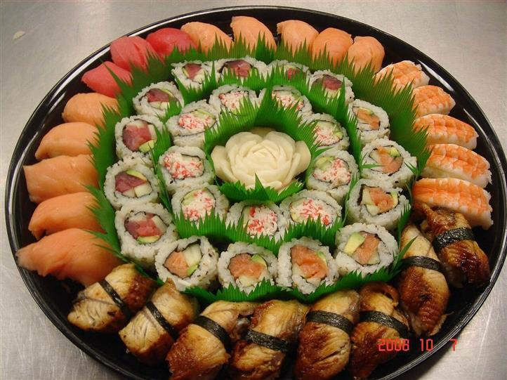 Assorted sushi rolls on catering platter
