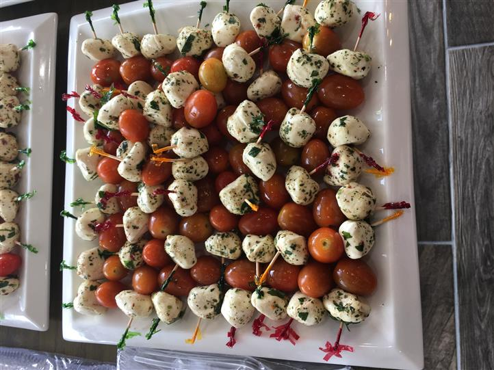 Dish with cherry tomatoes and cheese balls