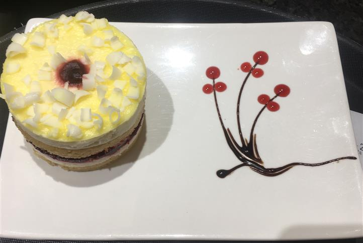 Fancy dessert on dish with syrup design