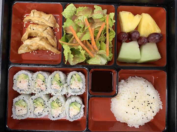 Bento box Served with fried dumpling, salad, seasonal fruits, california roll and steamed rice